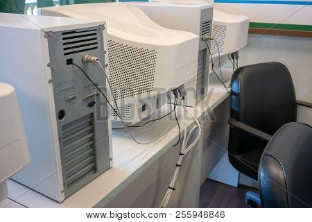 Old Crt Computer Monitors And Towers In Classroom.