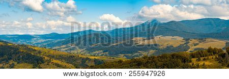 Beautiful Hilly Countryside In Autumn. Beautiful Weather With Clouds On A Blue Sky Above The Distant