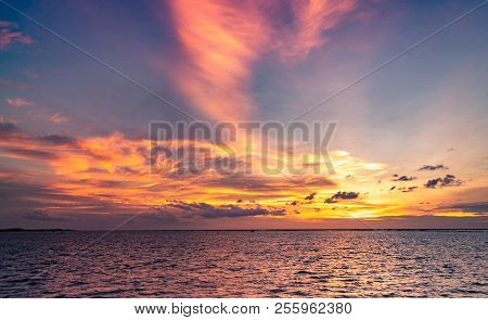 Beautiful Sunset Sky. Beach Sunset. Twilight Sea And Sky. Tropical Sea At Dusk. Dramatic Orange And
