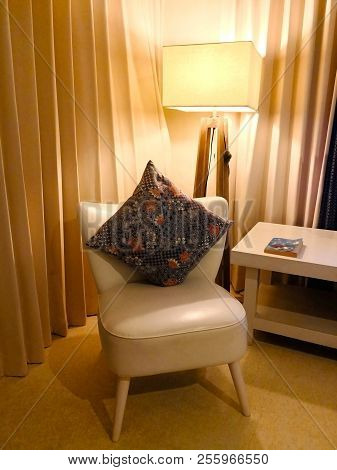 Cushion With Floral Pattern, Which Uses Local Woven Fabric. Place On The White Chair. At The Corner