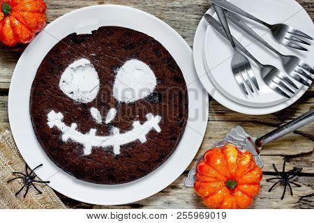 Jack Skeleton Cake, Halloween Chocolate Cake Decorated With Powdered Sugar On Vintage Wooden Backgro