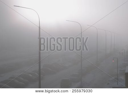 Fog In The City. Landscape With A Street Enveloped In Thick Fog