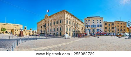 Valletta, Malta - June 17, 2018: Ensemble Of Castille Square With Old Wall Of St James Bastion, Aube