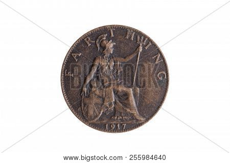 Old pre decimal 1917 George V farthing coin of England UK reverse Britannia cut out and isolated on a white background poster