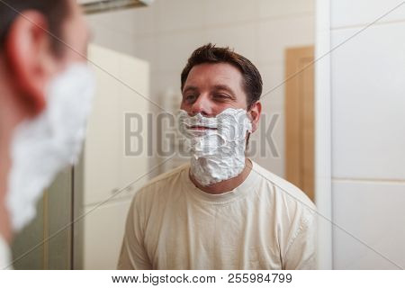 Close Up Portrait Of A Handsome Man With Shaving Foam On His Face