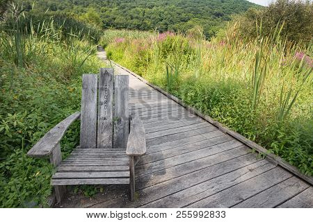 Chair On The Appalachian Trail Marking Georgia Bound Trail On The Swamp River Boardwalk In Pawling,