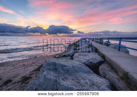 Sunrise Beach Scenic Seascape. Coastal Scenic Sunrise Beach On The Rocky Shore Of Lake Huron In Lexi