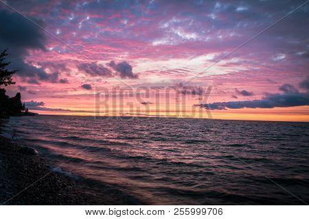 Gorgeous Michigan Beach Sunset. Sunset On The Shore Of Lake Huron In Cheboygan Michigan.