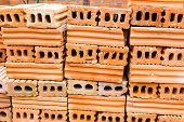 Stacks of terra cotta bricks, good background for construction theme poster
