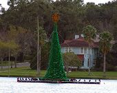 christmas tree floating on a lake in florida poster