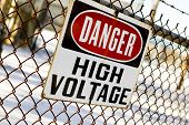 a danger high voltage sign at a power plant poster