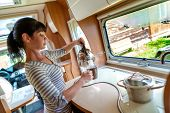 Woman cooking in camper, motorhome interior VR. Family vacation travel, holiday trip in motorhome, Caravan car Vacation. poster