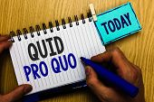 Conceptual hand writing showing Quid Pro Quo. Business photo showcasing A favor or advantage granted or expected in return of something Man holding marker expressing ideas notebook reminder wood. poster
