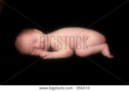 Infant On Black Background