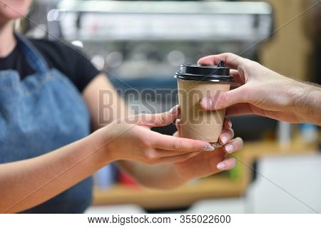 The Bartender Girl Gives The Customer Coffee In A Paper Cup, Hands Close-up. Small Business, People