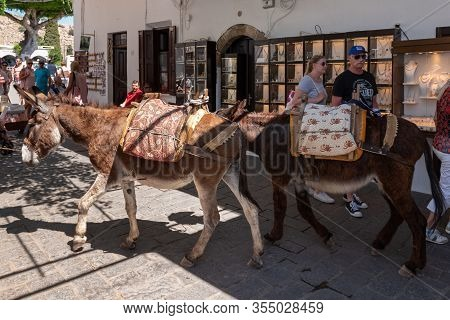 Rhodes, Greece - May 14, 2018: Donkey Are Waiting For Tourists. Using Donkey Taxi To The Acropolis I