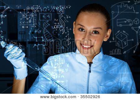Young scientist in laboratory in white uniform