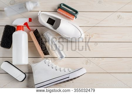 White Shoes And Cleaning Tools: Brushes, Sponge And Various Sprays