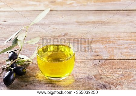 Healthy Fats. Bowl Of Glass Full Of Extra Virgin Olive Oil Made In Puglia, Salento On A Wooden Table