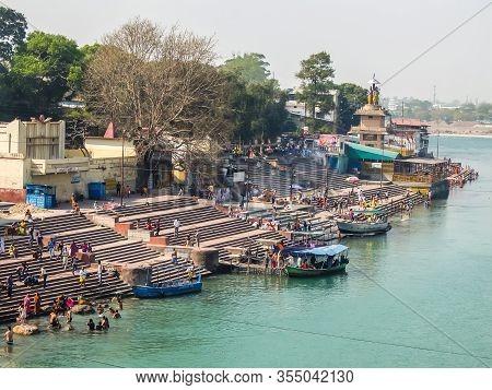 Rishikesh, India - Circa April 2018. People Bathing On The Ganga Riverbank In Rishikesh.