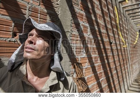 Penedo, Alagoas, Brazil - July 04, 2016: Mason At Work In A House Construction In A Small City Of No