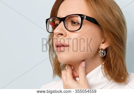 Close Up Of Business Woman Touches Fingers Of Sore Throat Over Blue Background. Thyroid Gland, Painf