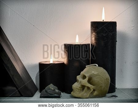 Three Black Burning Candles With Pyramid And Skull. Esoteric, Wicca And Occult Background, Fortune T