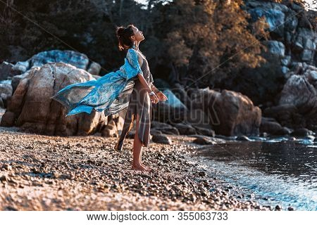 Beautiful Young Stylish Woman On The Beach At Sunset