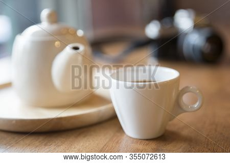 Coffee And Tea Time Concept.cup Of Coffee Or Tea ,old Dslr Camera And Teapot On Wooden Table.relaxin