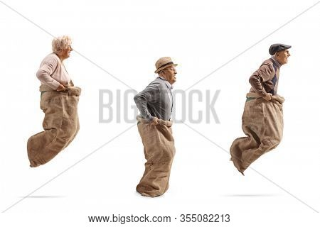 Senior people playing gunny race and jumping in a sack isolated on white background