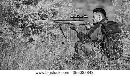 Man Wear Camouflage Clothes Nature Background. Hunting Permit. Hunting Equipment For Professionals.