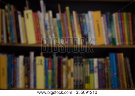 Abstract Defocused Background. Books In University Library, Education Theme