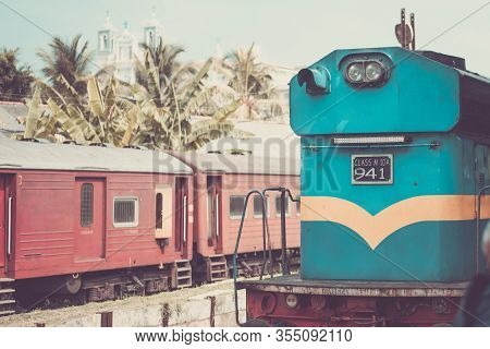 A Blue Old Train Stands On The Tracks Of A Railway Station In Galle Sri Lanka