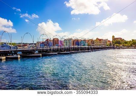 Willemstad, Curacao, Netherlands - December 5, 2019: Queen Emma Bridge In Front Of The Punda Distric