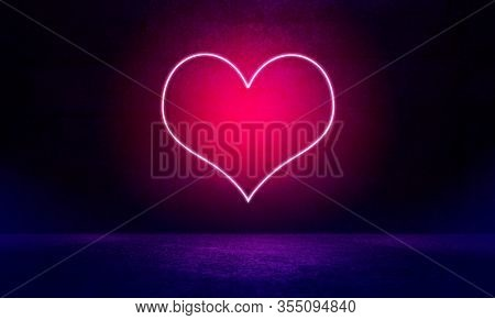 Neon heart shape light on wall