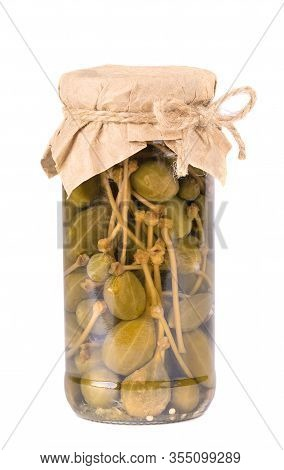 Pickled Caper Berries In Jar Isolated On White Background. Capers Isolated On White Background. Pick