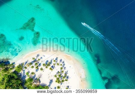 Aerial Drone View Of Beautiful Caribbean Tropical Island Cayo Levantado Beach With Palms And Boat. B