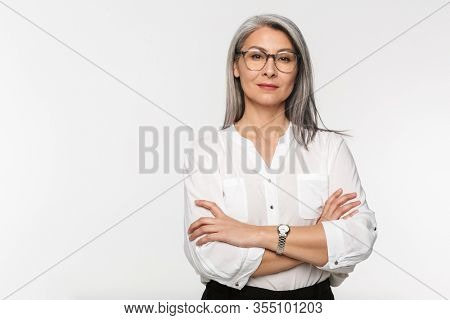 Image of adult mature woman with long gray hair wearing eyeglasses and office clothes isolated over white background