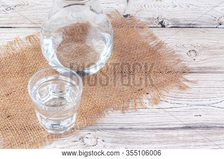 Glasses Of Water On A Wooden Table. Creative Photo.