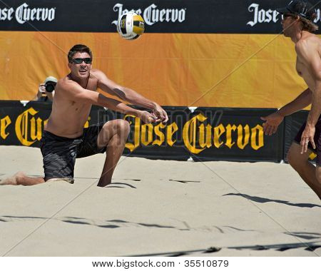 HERMOSA BEACH, CA - JULY 21: Mark Williams and Stein Metzger compete in the Jose Cuervo Pro Beach Volleyball tournament in Hermosa Beach, CA on July 21, 2012.