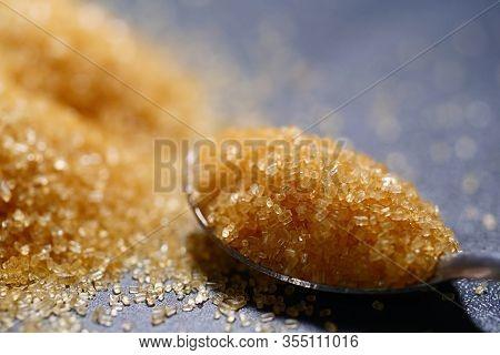 Close Up Of Brown Sugar In Spoon