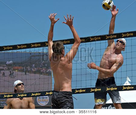 HERMOSA BEACH, CA - JULY 21: John Hyden, Sean Scott  and Mark Williams  compete in the Jose Cuervo Pro Beach Volleyball tournament in Hermosa Beach, CA on July 21, 2012.
