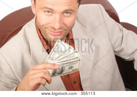 Smiling Man With Few Houndred Dollars Bills In The Hand - Isolated