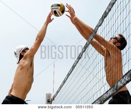 HERMOSA BEACH, CA - JULY 21: Ryan Doherty and John Hyden compete in the Jose Cuervo Pro Beach Volleyball tournament in Hermosa Beach, CA on July 21, 2012.