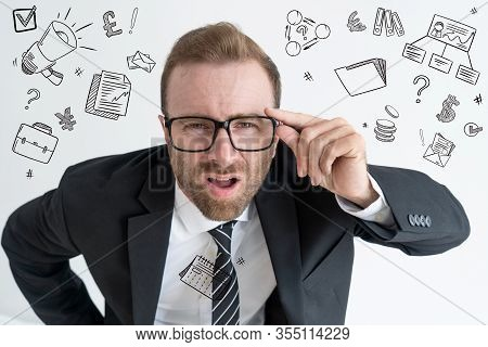 Boss Staring At Camera With Hand Drawn Business Sketches. Surprised Man Looking Through Glasses. Sur