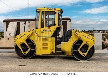Torrevieja, Valenciana, Spain - Mar 01 2020 : Bomag Heavy Weight Road Roller Parked In Spanish Urban