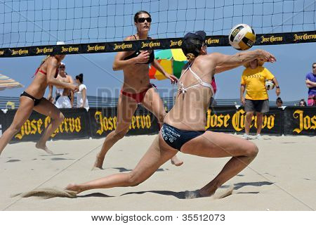 HERMOSA BEACH, CA - JULY 21: Morgan Beck and Kaitlin Sather compete in the Jose Cuervo Pro Beach Volleyball tournament in Hermosa Beach, CA on July 21, 2012.