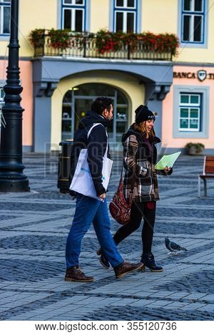 People And Tourists Wandering On The Streets Of Sibiu Old Town. Sibiu, Romania, 2020.