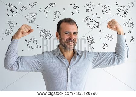 Latin Man Showing His Biceps With Hand Drawn Business Sketches. Cheerful Powerful Handsome Businessm