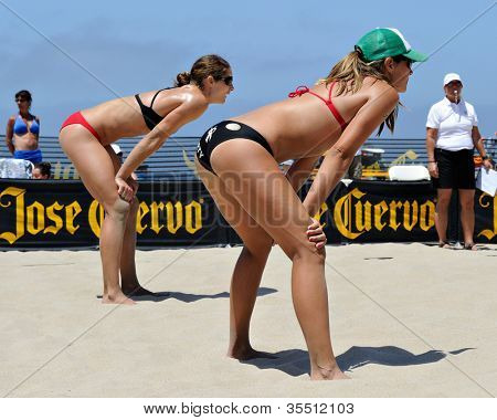 HERMOSA BEACH, CA - JULY 21: Kaitlin Sather and Michelle Moriarty compete in the Jose Cuervo Pro Beach Volleyball tournament in Hermosa Beach, CA on July 21, 2012.